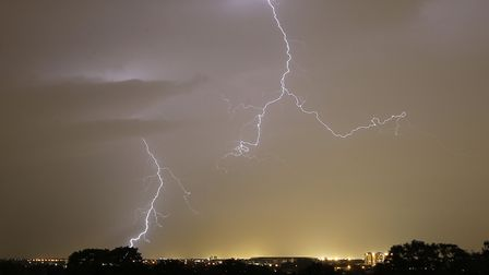 Lightning strikes over the Heathrow area from Richmond Hill, west London, late last night.