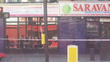 A police officer was pushed through the window of an Ilford restaurant as he attempted to arrest a w