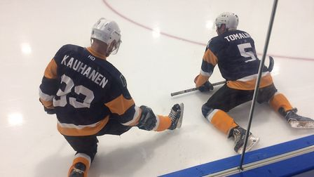 Timo Kauhanen and Rich Tomalin stretch before play