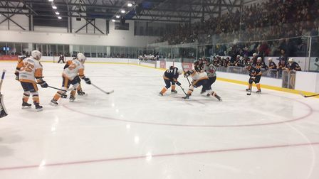 Action from the match between Raiders and Legends