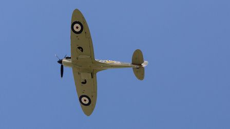 A Spitfire flying over R J Mitchell Primary School in Hornchurch. Photo: Vickie Flores