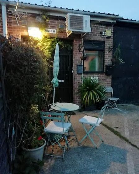 The outdoor patio of the alleged brothel on the Kings Estate. Photo: Archant