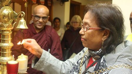 Visitors lit candles at the Buddhist Centre, in Balfour Road. Photo: Demi Butcher