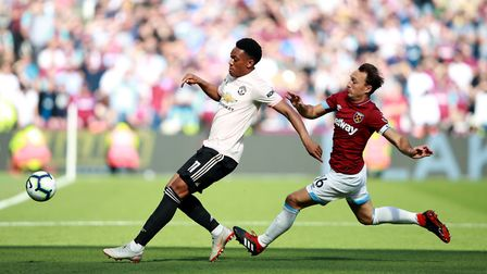 Manchester United's Anthony Martial (left) and West Ham United's Mark Noble battle for the ball duri