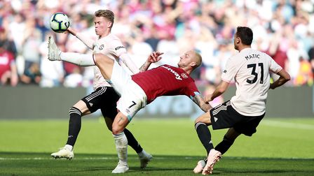 West Ham United's Marko Arnautovic (front) and Manchester United's Scott McTominay battle for the ba