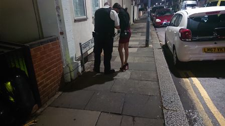 A town centre police officer issuing a dispersal notice to a sex worker. Picture: Ellena Cruse