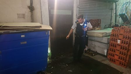 Police search a well-known lane in Ilford. Picture: Ellena Cruse