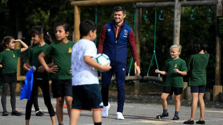 EPTEMBER 20: Aaron Cresswell of West Ham United visits Snaresbrook Primary School on September 20,