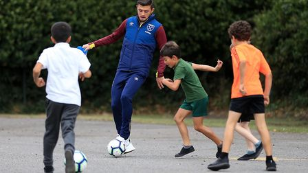 Aaron Cresswell of West Ham United visits Snaresbrook Primary School on September 20, 2018 in