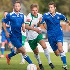 Ryan Jarvis (l) and Ross Jarvis (c)(r) of Lowestoft Town during the FA Cup Qualifying second round m