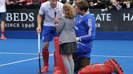 East London Science School pupils Evie Dooley and George Kingham with Great Britain hockey players H