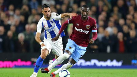 Brighton & Hove Albion's Beram Kayal (left) and West Ham United's Pedro Obiang battle for the ball d