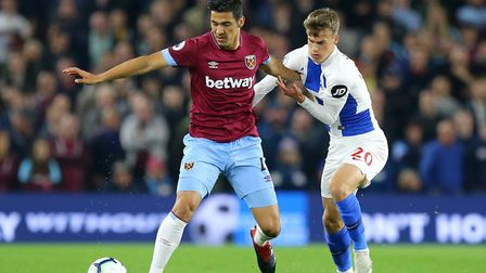 West Ham United's Fabian Balbuena (left) and Brighton & Hove Albion's Solly March battle for the bal