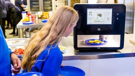 Year Six pupils watching the 3D printer creating the geometric fish and chips. Picture: Nigel Davies