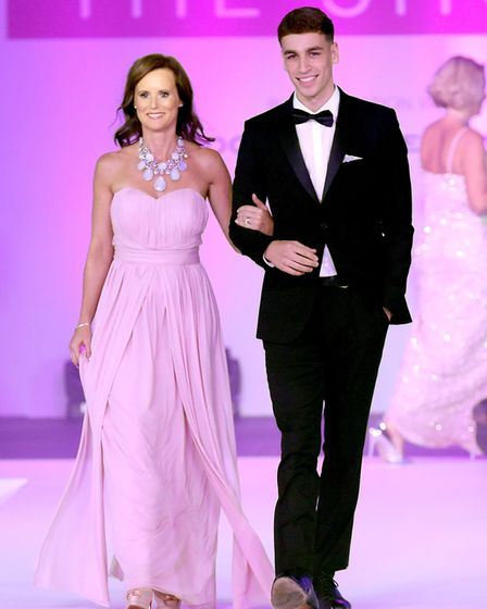 Rowan Hostler walks the runway during the Breast Cancer Care London Fashion Show in association with