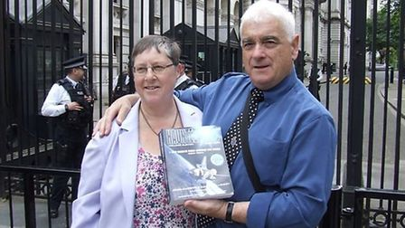 John Hanson and his wife Dawn pictured outside Downing Street with his Hanuted Skies book.