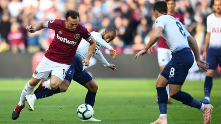 West Ham United's Mark Noble (left) and Tottenham Hotspur's Lucas Moura battle for the ball during t