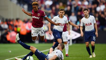 West Ham United's Grady Diangana jumps over a challenge from Tottenham Hotspur's Eric Dier during th