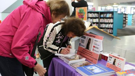 Author Irene Martinez (right) signing a book for Moira Clark from Wanstead.