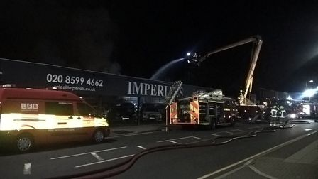 Firefighters battle a blaze at Imperials car delearship in Chadwell Heath on Saturday, November 3. P