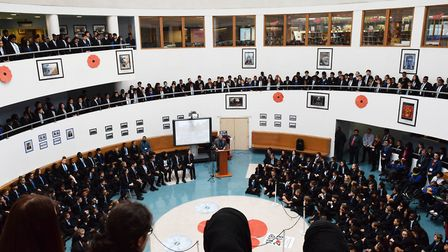 Pupils and staff gather to mark Armistice Day at Royal Docks Academy. Picture: Kelly Clark