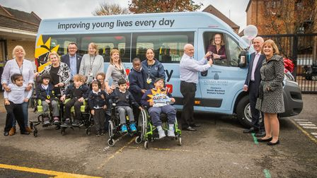 Pupils celebrating their new bus before heading out in its' first trip to a Stratford trampoline par