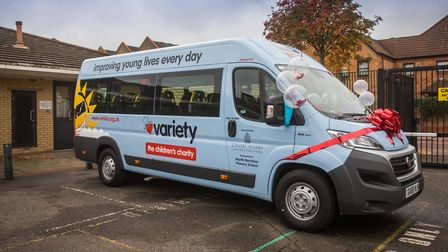 The bus for North Beckton Primary School pupils, which was given by children's charity Variety and C