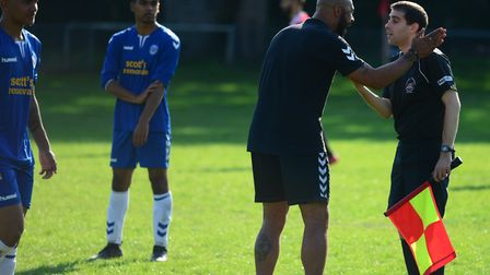 Woodford Town coach Ross Weare speaks with a referee (pic: Tim Edwards).