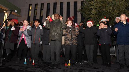 Children singing and enjoying the Christmas lights turn on in Ken Aston Square in Barkingside.