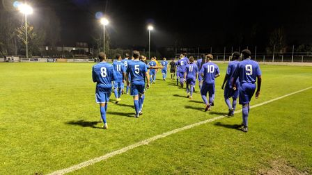 Players from Walthamstow (left) and Barkingside (right) both walk out in blue kits ahead of their Es