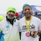 Sikhs In The City annual Dawn to Dusk Race director Harmander Singh with View Tube Runners' Andre El