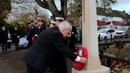 Councillor Brian Eagling laying at wreath at the service in Harold Wood on Sunday. Photo: Sandra Row