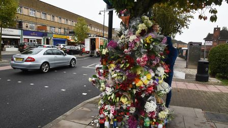 Flowers left in Manford Way in tribute to Moses Mayele who was stabbed to death on his 23rd birthday