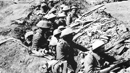 British infantrymen occupy a shallow trench before an advance during the Battle of the Somme. Photo: