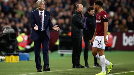 West Ham United manager Manuel Pellegrini (left) speaks to Ryan Fredericks during the Carabao Cup, F