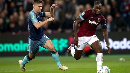 Tottenham Hotspur's Juan Foyth (left) and West Ham United's Michail Antonio battle for the ball duri