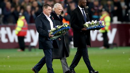 Tony Cottee, David Gold and Ledley King lay wreaths on the pitch in honour of the Leicester City hel