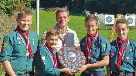 The Lowestoft and District Scouts archery winners line up with their trophy. Picture: MICK HOWES