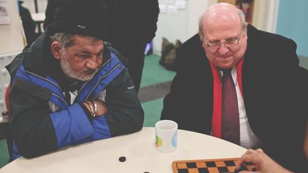 Kawal Singh plays chess with Mike Gapes at the Ilford Salvation Army night shelter. Photo: Anja King