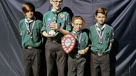 The Lowestoft and District Scouts shooting competition winners line up with their trophy. Picture: M