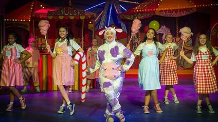 Claire Greenway as Pat the Cow with the junior chorus in the Queen's Theatre's Jack and the Beanstal