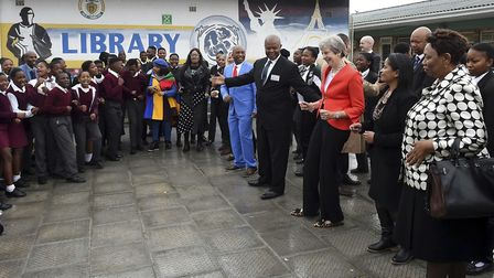 Theresa May meets staff and pupils during a visit to the ID Mkhize High School in Gugulethu, Cape To