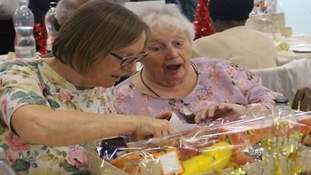 As students gave out the hampers, residents were treated to a Christmas meal and there was a festive