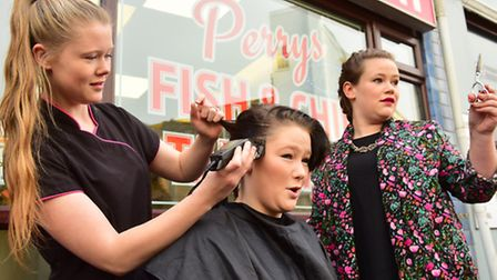Chip shop worker Emma Douglas has her head shave to raise money for Cancer charities.