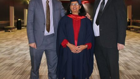 Krishna James, centre, at her graduation with her son Sathya and husband Trevor. Picture: UEL