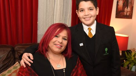 Young carer Ilyan Benamor, 12, with his mum Laila Chikhaoui. Picture: Ken Mears