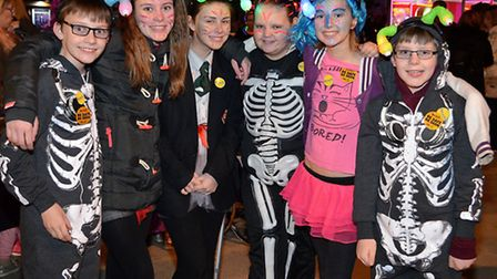 ALL AGLOW: Some of the many children and adults who took part in the fourth annual Glow Walk for EAC