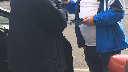 An enforcement officer, carrying out a check with a driver found using a blue badge belonging to his