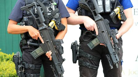 Armed police headed to Ilford. Picture: Peter Byrne