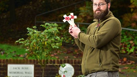 Lowestoft War Museum curator Robert Jarvis with this year's poppy crosses.
